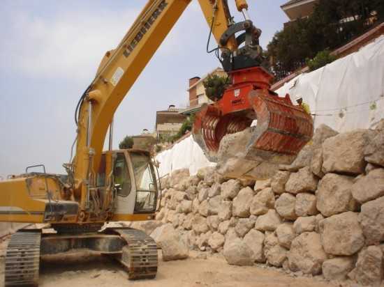 NPK DG-30 demolition & sorting grab, moving large boulders to control erosion