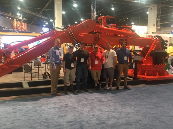 NPK booth, ConExpo 2017 - B6500 pedestal boom and NPK sales team members with J.R. Vinagro staff