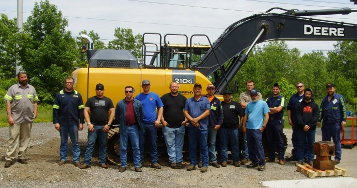 June 2018 NPK Service Conference - group shot with the excavator used for the rodeo