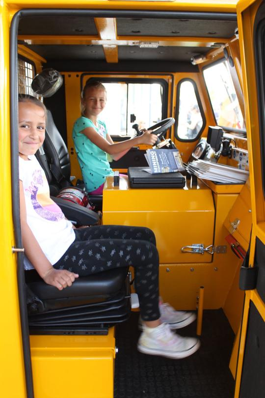 Elko Daily Free Press - Elko Mining Expo 2018 - two girls in the MinCa 5.1 utility vehicle