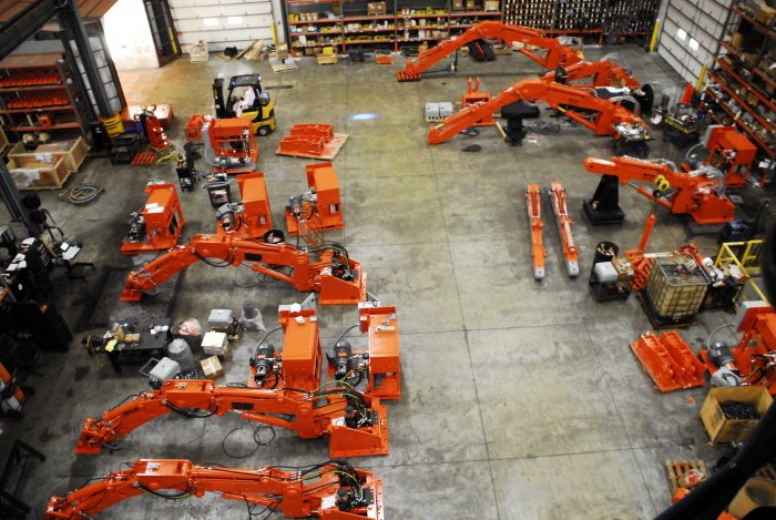 Several pedestal boom systems in progress on the assembly floor at NPKCE
